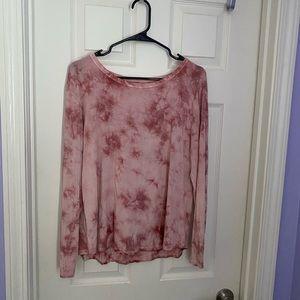 A pink tie- dye, flowy top.